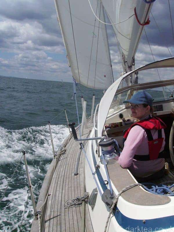 A woman sitting in a sailing boat