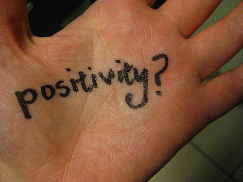 Positivity written on a persons hand