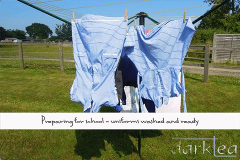 school uniform drying outside