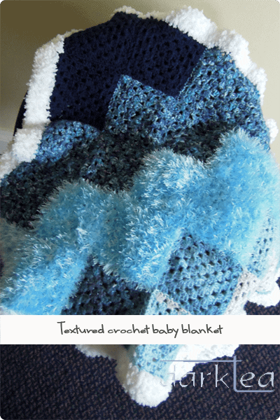 Crocheted blanket using different textures of wool