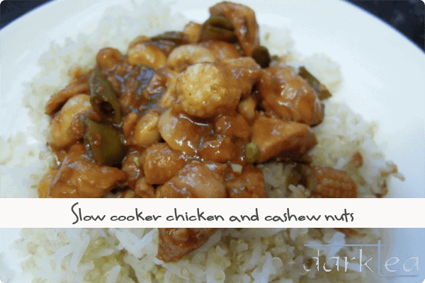 A plate of food with rice meat and vegetables - chicken and cashew nuts made in the slow cooker
