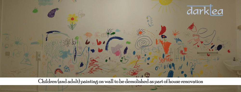 children's drawing on a white wall