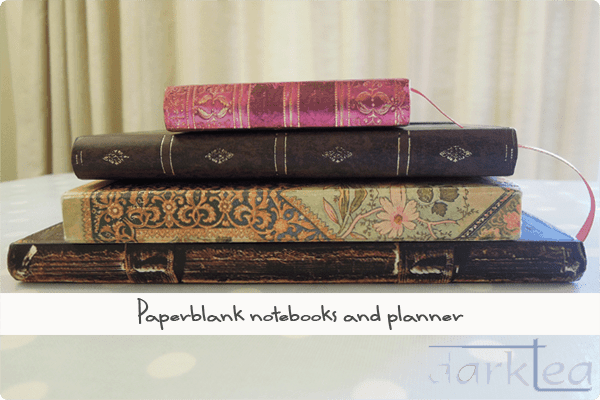 a pile of paperblank notebooks