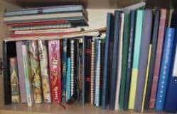A book shelf filled with journals