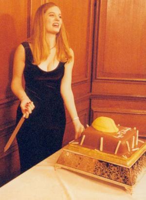 A woman cutting a cake