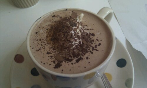 A cup of chococo hot chocolate with ice cream in it