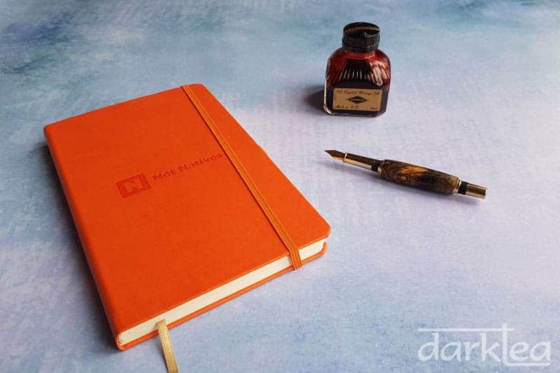 My 2018 journal is an orange castelli notebook and I write in red Diamine ink